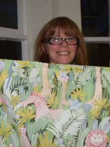 Mandy making a toy bag out of old curtains